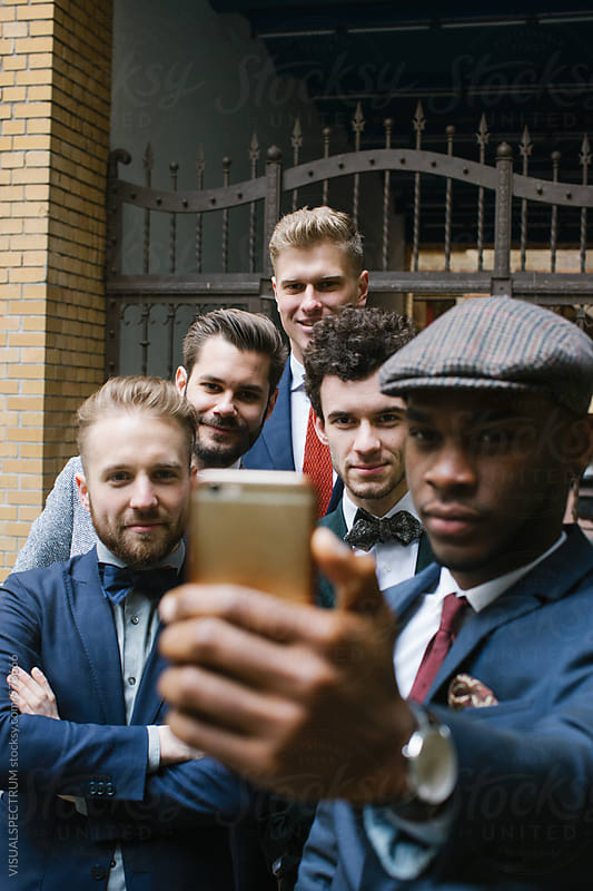Five Stylish Young Men Taking Selfie Outdoors by Julien L. Balmer for Stocksy United