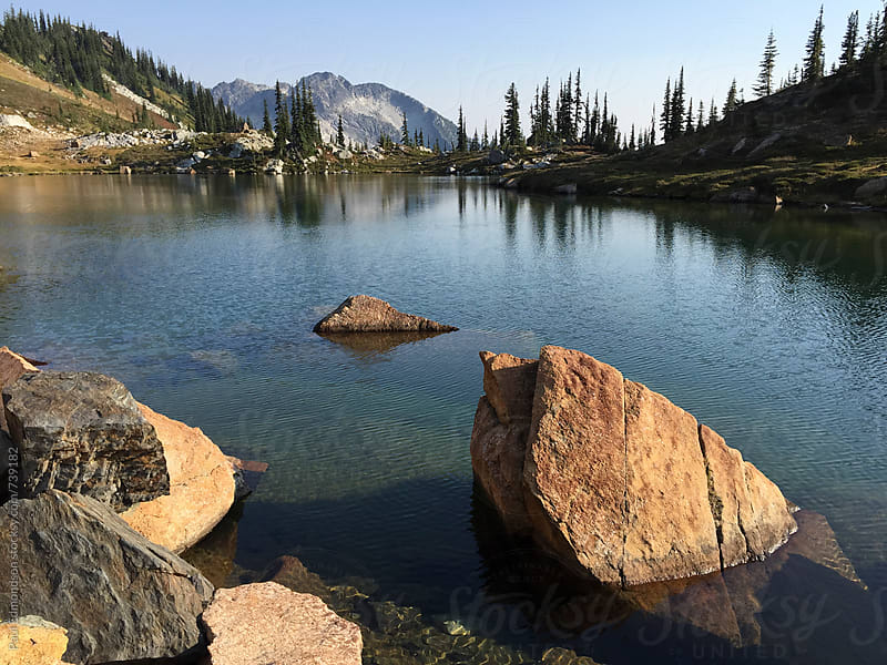 View of pristine alpine lake at dusk, Central Cascades, WA by Paul Edmondson for Stocksy United