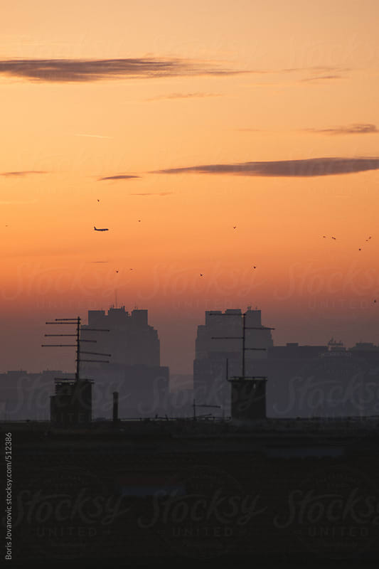 Sunset over the city scape by Boris Jovanovic for Stocksy United