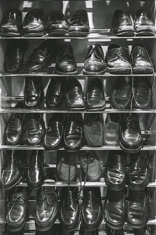 Shoes on man dressing room. by BONNINSTUDIO for Stocksy United