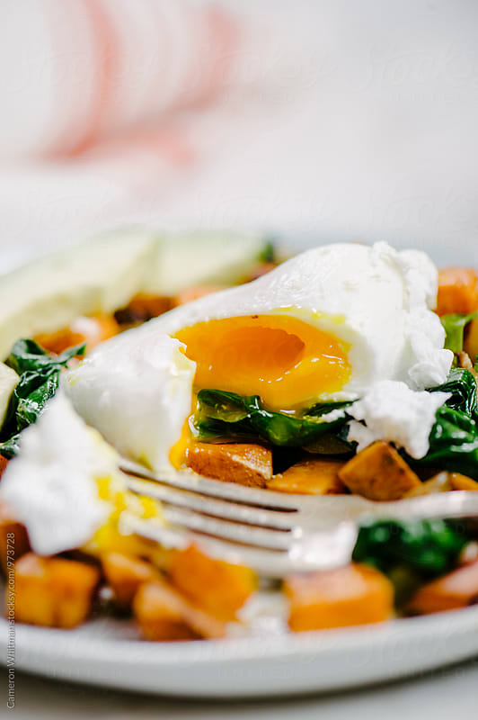 Sweet Potato Hash and Eggs by Cameron Whitman for Stocksy United
