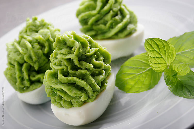 Stuffed eggs with pea and mint purée by Ferenc Boros for Stocksy United