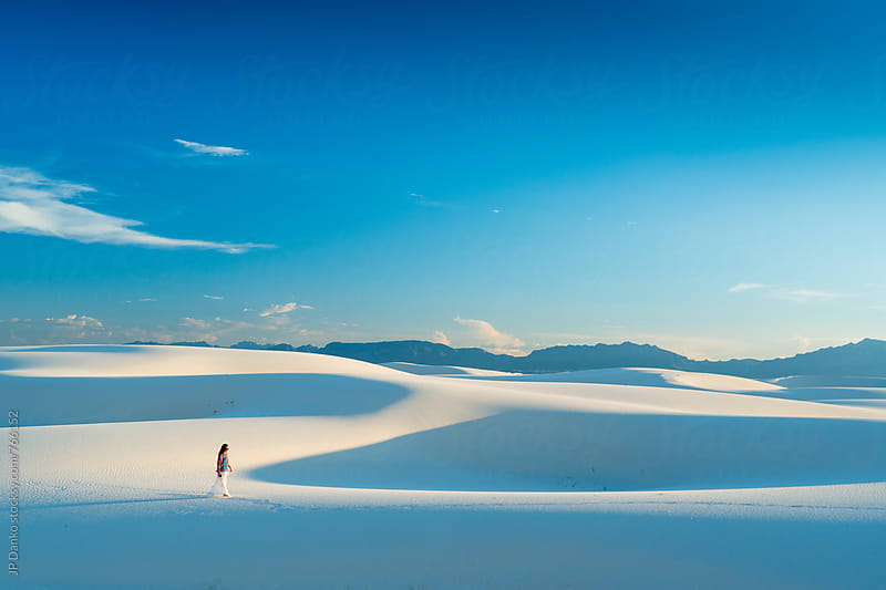 Dramatic Woman In Skirt Walking on White Sand Dunes In White Sands National Monument New Mexico by JP Danko for Stocksy United