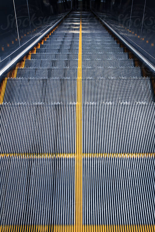 escalator in subway station of Beijing by zheng long for Stocksy United