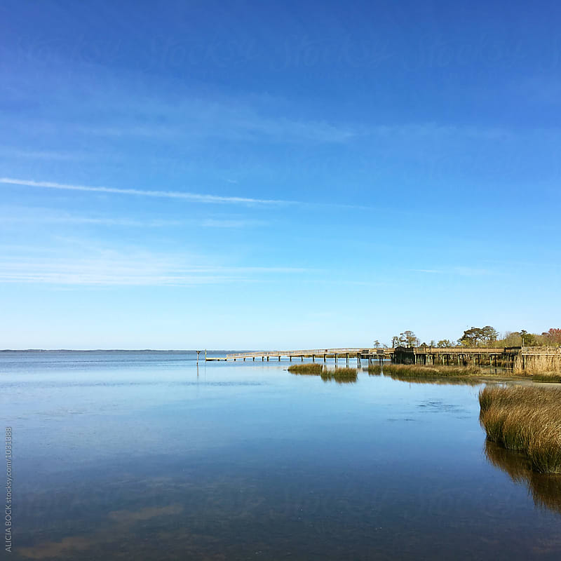 Looking At The Currituck Sound And The Boardwalk Of Duck, North Carolina by ALICIA BOCK for Stocksy United