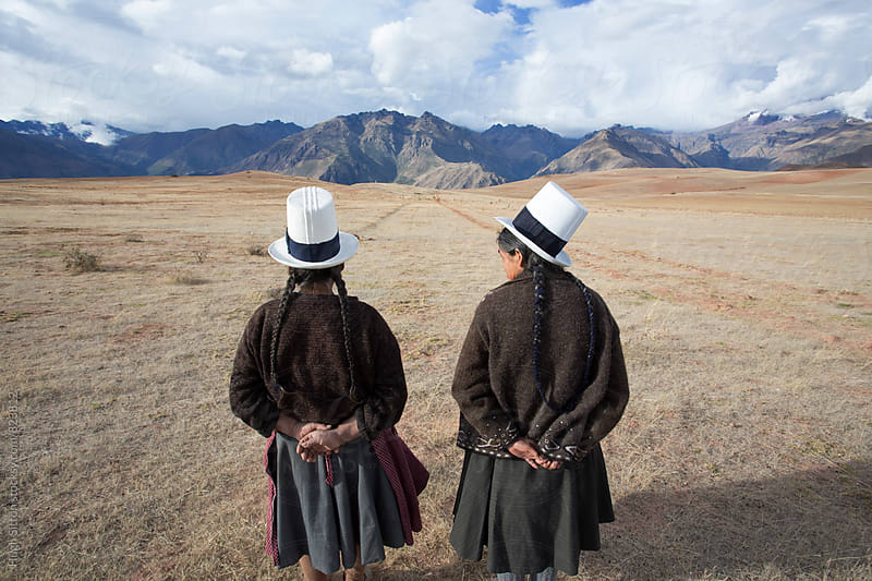 Traditionally Dressed Peruvian women. Peru. by Hugh Sitton for Stocksy United