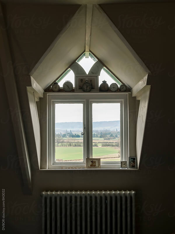 View of English Countryside through an attic window by DV8OR for Stocksy United