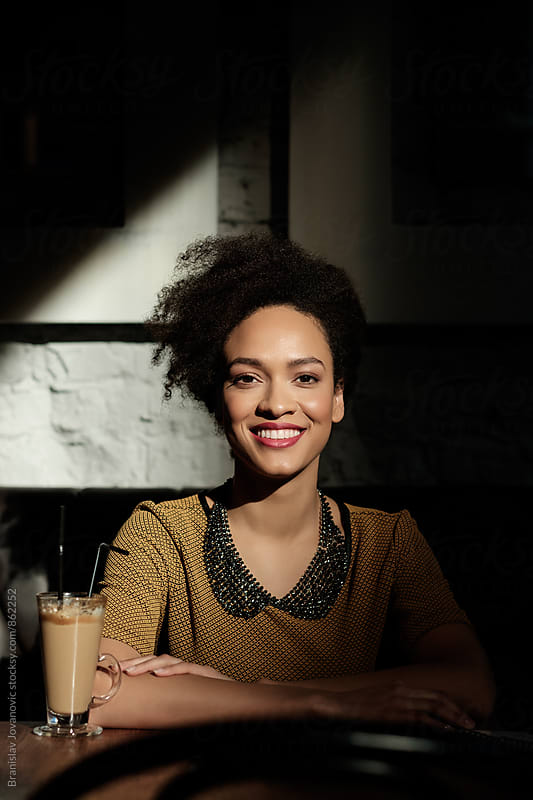 Portrait of a Beautiful Black Woman Smiling by Branislav Jovanović for Stocksy United