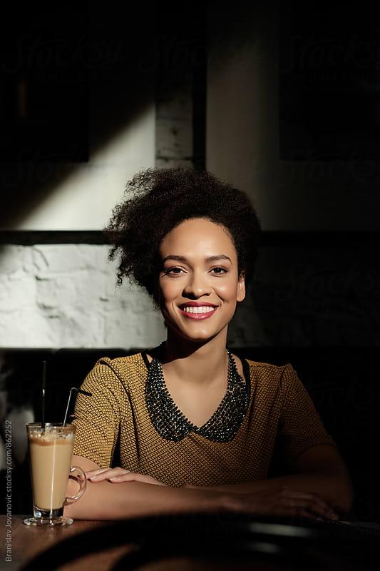 Portrait of a Beautiful Black Woman Smiling by Branislav Jovanovic for Stocksy United