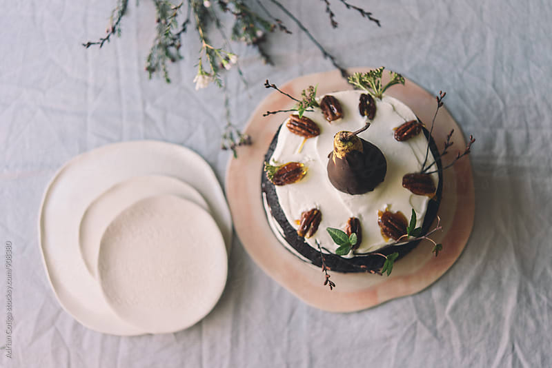 Caramelized fruits cake; seen from above by Adrian Cotiga for Stocksy United