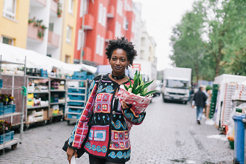 Woman at outdoor Market by VegterFoto for Stocksy United