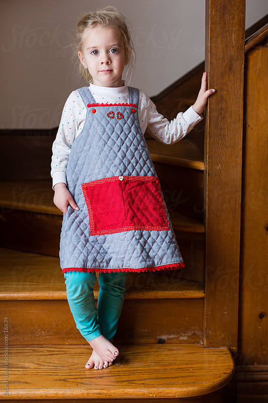 young girl wearing homemade jumper by Brian Powell for Stocksy United