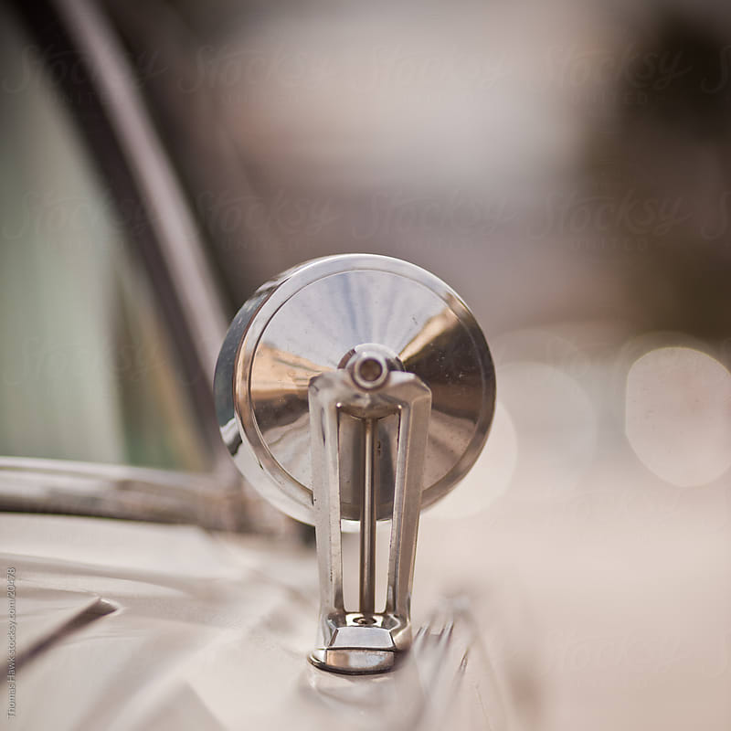 car mirror detail by Thomas Hawk for Stocksy United