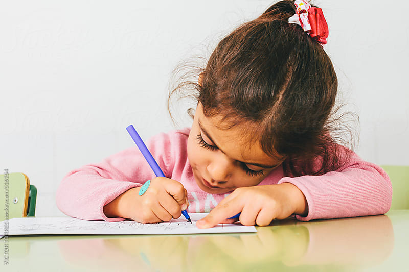 Little Adorable Girl Drawing at School by VICTOR TORRES for Stocksy United