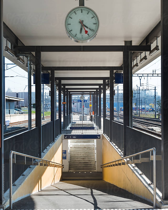 Train station platform and corridor - vertical by Gabriel Diaz for Stocksy United