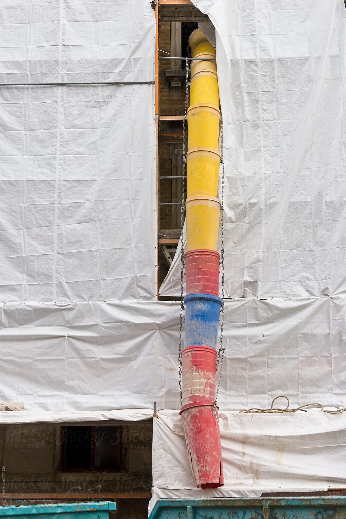 Stock Photo - Construction Site With Plastic Tarp And Rubble Chute