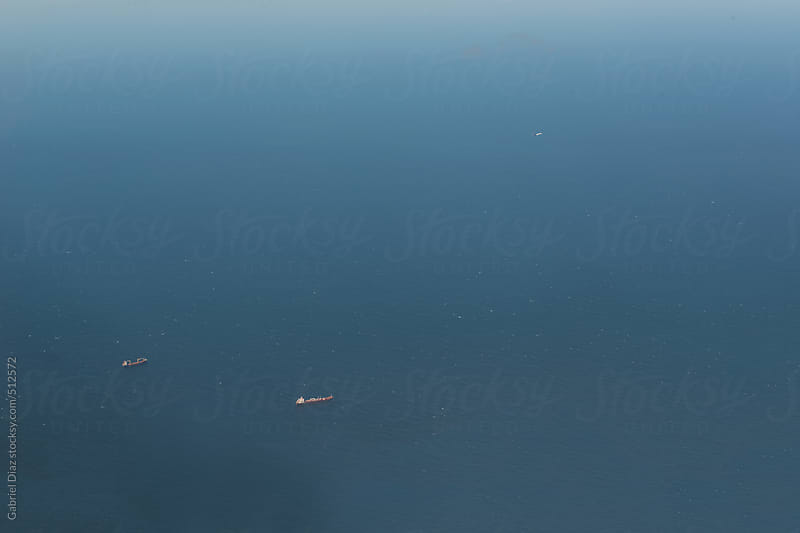 oil tankers on the sea by Gabriel Diaz for Stocksy United