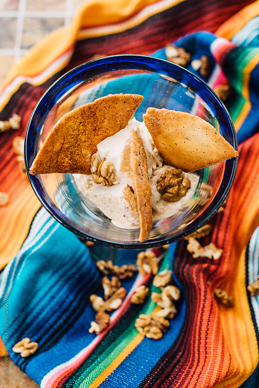 Caramel ice cream with nuts  by Boris Jovanovic for Stocksy United