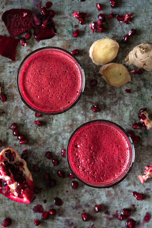 Beetroot, pomegranate and ginger juice by Pixel Stories for Stocksy United