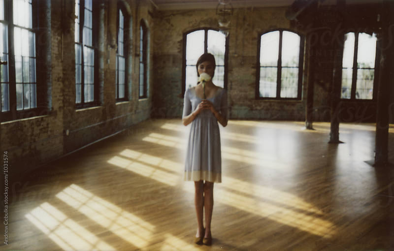 Polaroids of Model in empty space with natural light by Andrew Cebulka for Stocksy United
