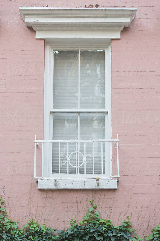 White window on pink building by Lauren Naefe for Stocksy United