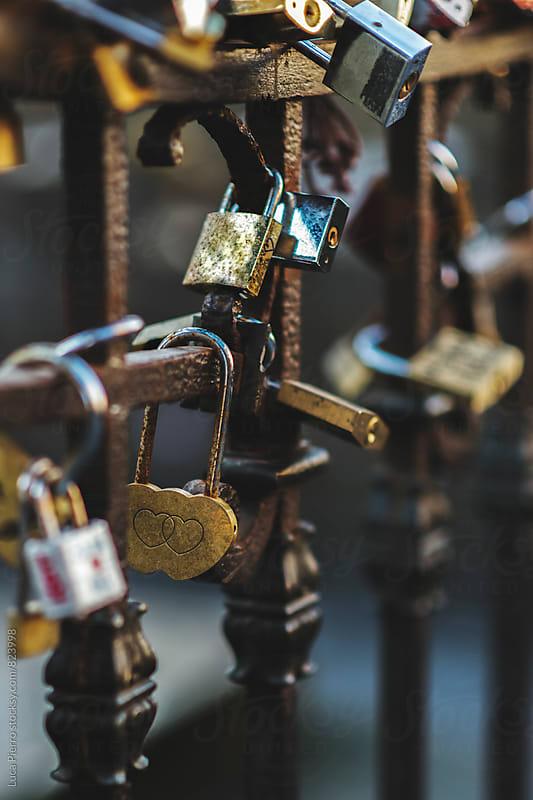 Love locks on fence  by Luca Pierro for Stocksy United