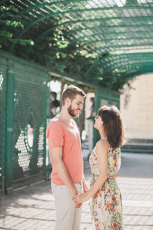 Couple in love looking at each other holding hands  by Irina Efremova for Stocksy United