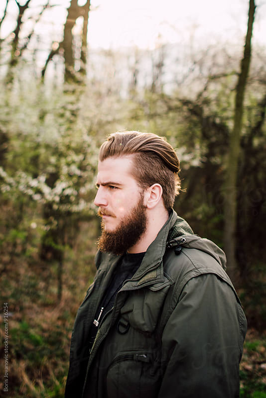 Portrait of stylish bearded man  by Boris Jovanovic for Stocksy United
