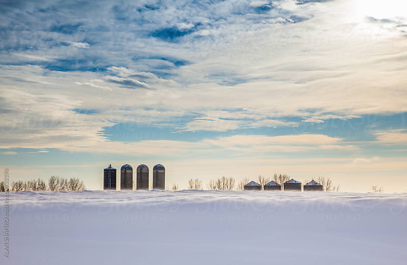 Farm Silos on the Prairie in winter by alan shapiro for Stocksy United