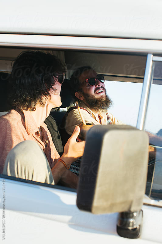 Hippie Road Tripping - Two Male Hippies Drinking Mate While Driving Camper Van by VISUALSPECTRUM for Stocksy United