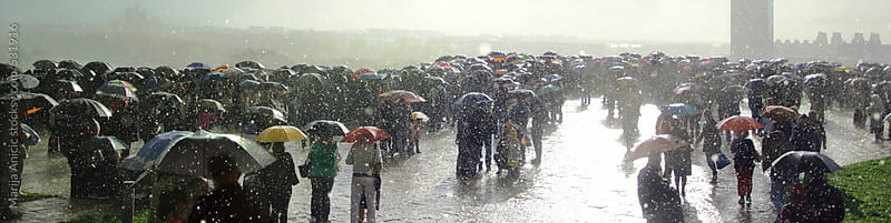 Rain,crowd,umbrellas and sun by Marija Anicic for Stocksy United