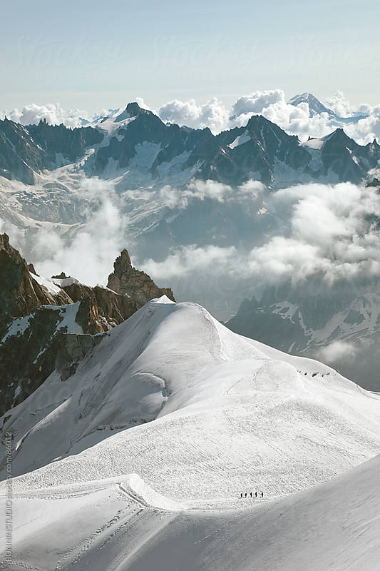 View of five aplinists climbing to montblanc. Beautiful Landscape, France. by BONNINSTUDIO for Stocksy United