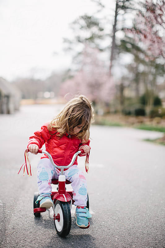 Toddler on her tricycle by Jakob for Stocksy United