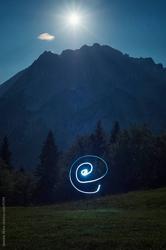 Light painting against mountain landscape by GIC for Stocksy United