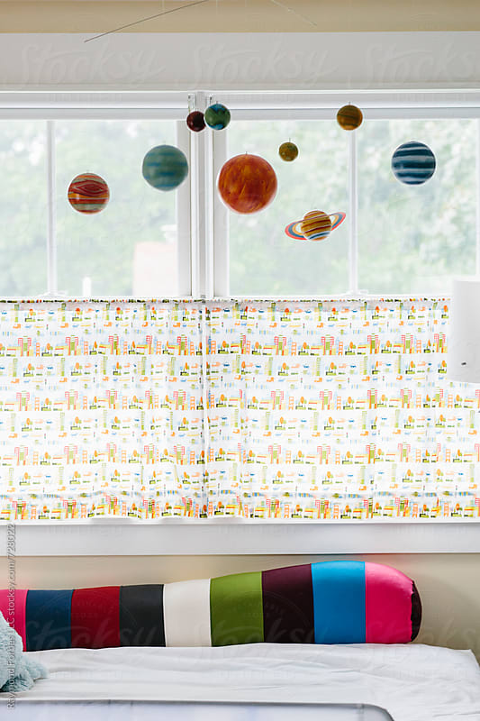 Solar System Mobile in Child's Bedroom by Raymond Forbes LLC for Stocksy United