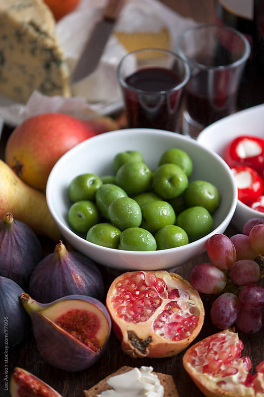olives, fresh fruit, port and cheese by Lee Avison for Stocksy United