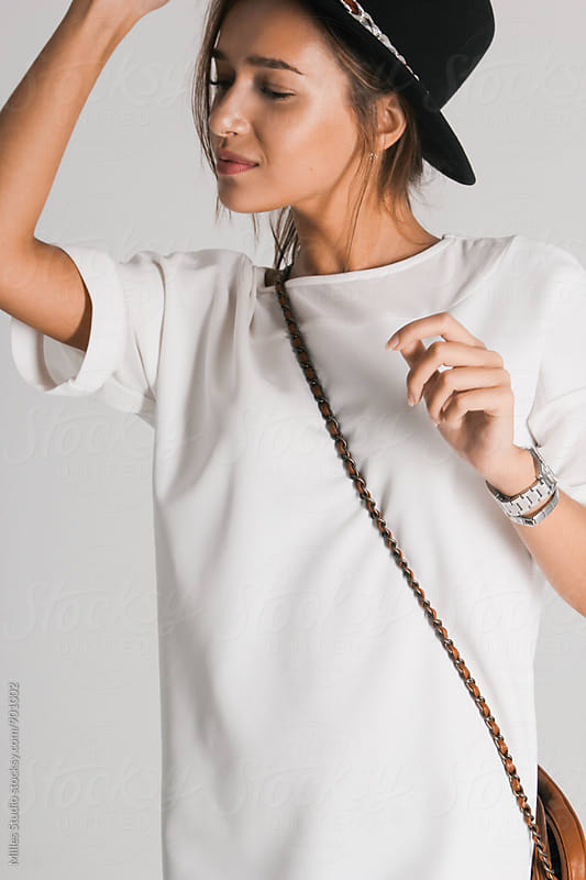 Woman wearing hat by Milles Studio for Stocksy United