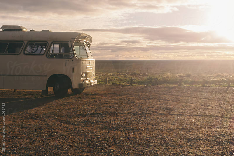 large white bus in outback Australia, used for a road trip by Gillian Vann for Stocksy United