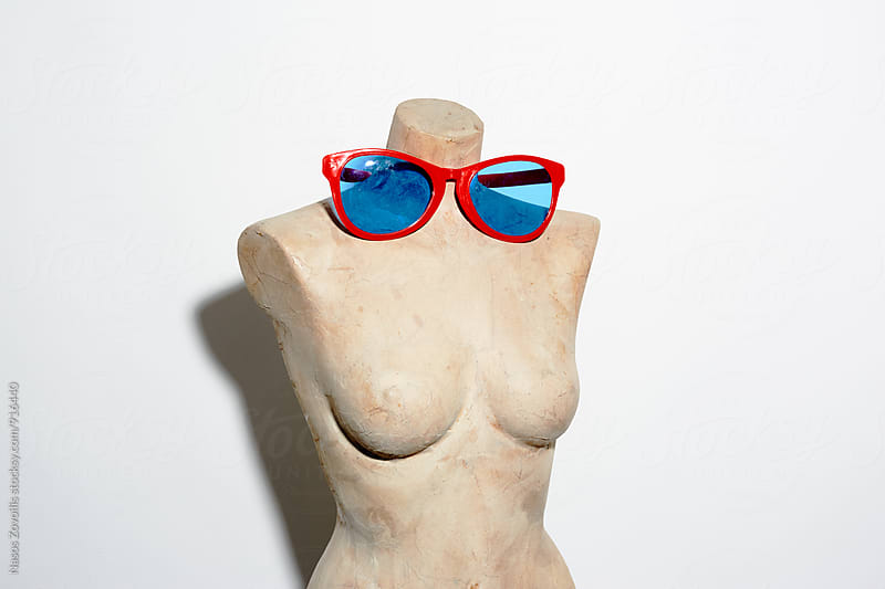 Studio shot of a doll wearing sunglasses by Nasos Zovoilis for Stocksy United