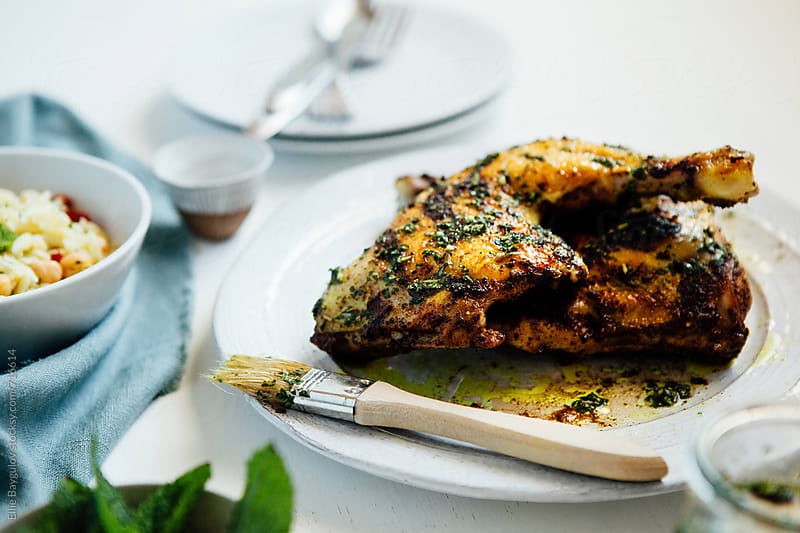 Grilled pesto chicken by Ellie Baygulov for Stocksy United