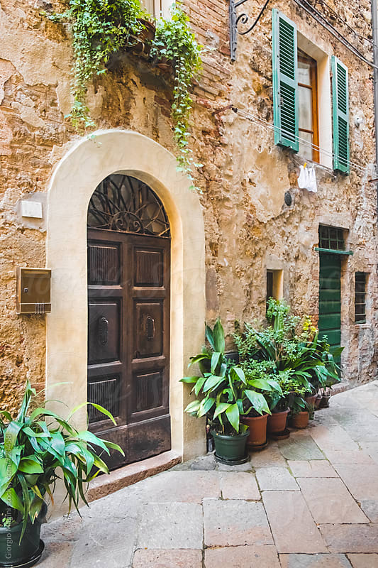 Wooden Doors and Potted Plants in an Old Tuscan Town by Giorgio Magini for Stocksy United