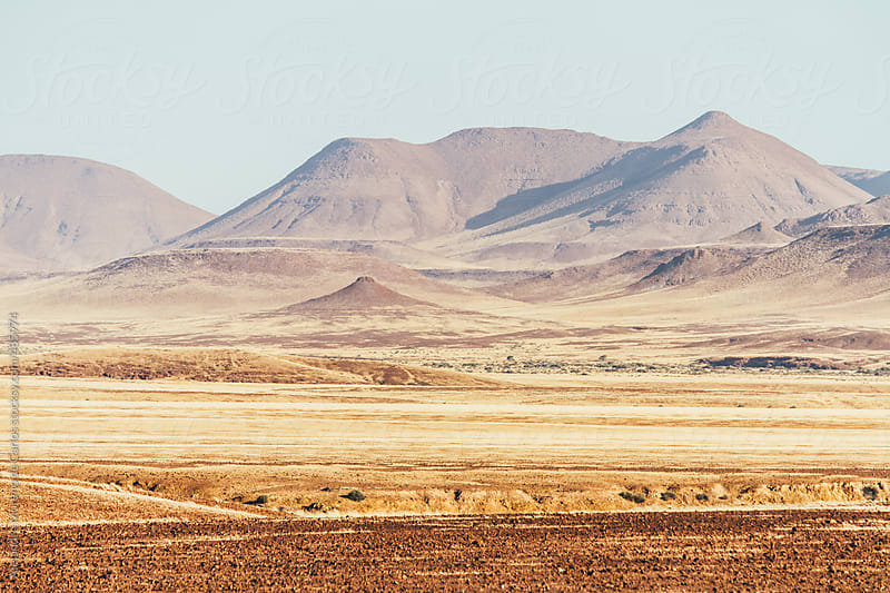 Mountain in desert landscape by Alejandro Moreno de Carlos for Stocksy United