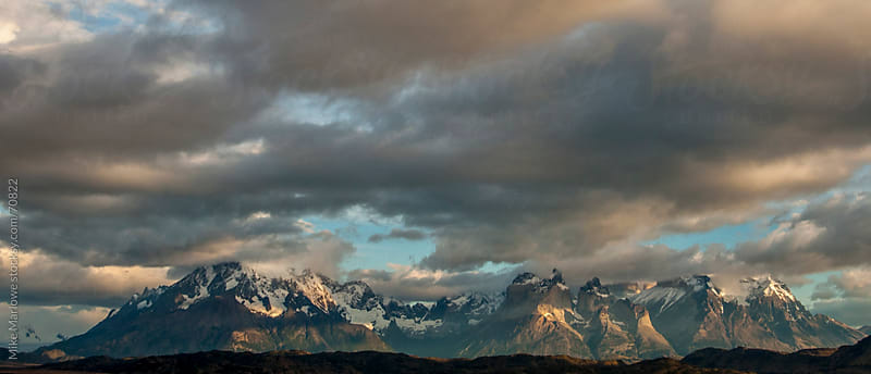 A row of mountains with dramatic clouds. by Mike Marlowe for Stocksy United