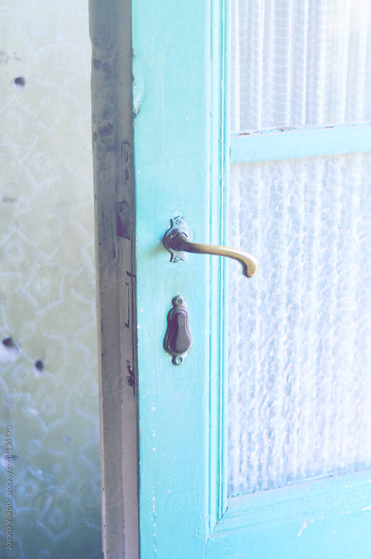 old  turquoise door by Jovana Vukotic for Stocksy United