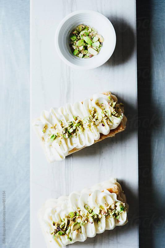 Vanilla millefeuille by Ellie Baygulov for Stocksy United