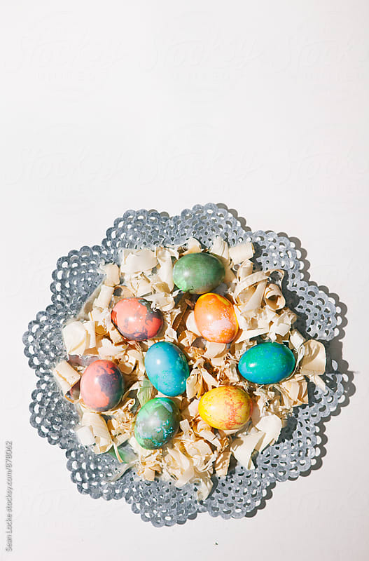 Easter: Colored Eggs On Platter On White Background by Sean Locke for Stocksy United