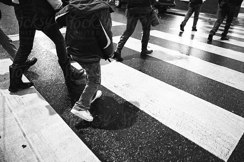 Pedestrians in a rush to cross the street by Lawrence del Mundo for Stocksy United