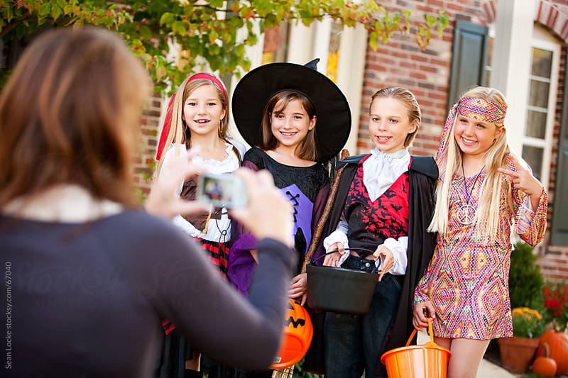 Halloween: Children Line Up In Costume for Picture by Sean Locke for Stocksy United