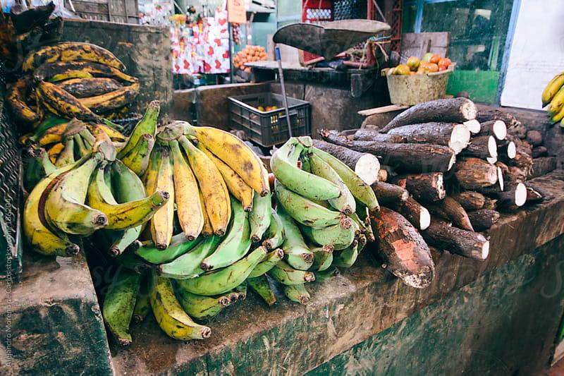 Bananas on a rural market by Alejandro Moreno de Carlos for Stocksy United