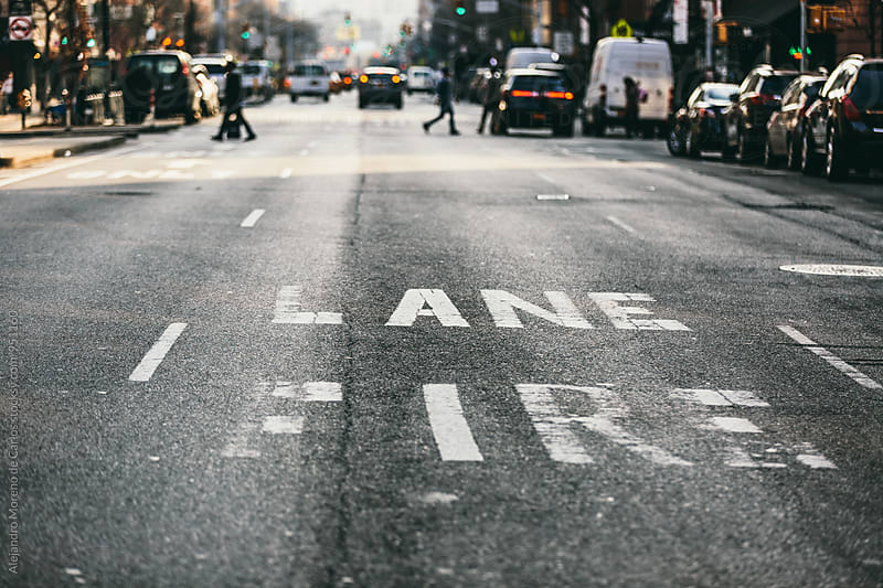 Pedestrians crossing New York road by Alejandro Moreno de Carlos for Stocksy United